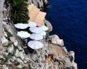 Impressive-looking Buža bar atop a cliff at the southern side of the Dubrovnik walls