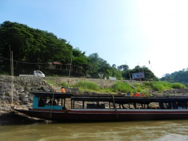 Crossing from Thailand to Laos by boat at the Mekong River