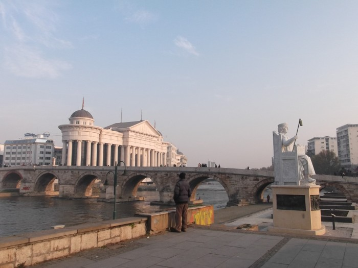 Stone Bridge on Vardar River with the latest built statues and Government buildings by the river.