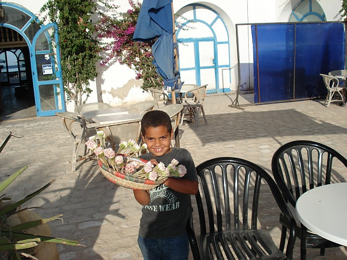 This is on the island Djerba. Little boy is selling Machmoum.