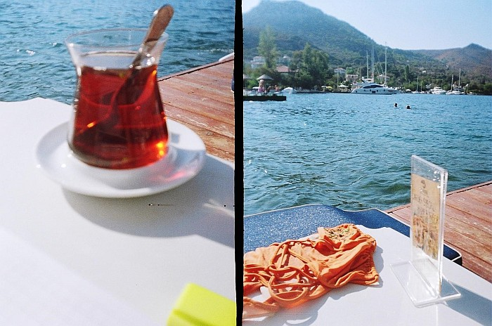 In this photo I'm enjoying my tea by the seaside on the dock in Selimiye