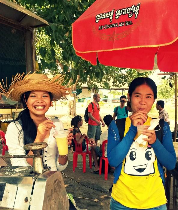 My sisters in Battambang, Chhorvy & Seav Young, drinking sugar cane juice :)