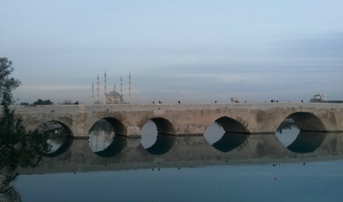 Taş Köprü ( Stone Bridge) with the view of Merkez Cami ( Central Mosque) behind. Seyhan, Central Adana.
