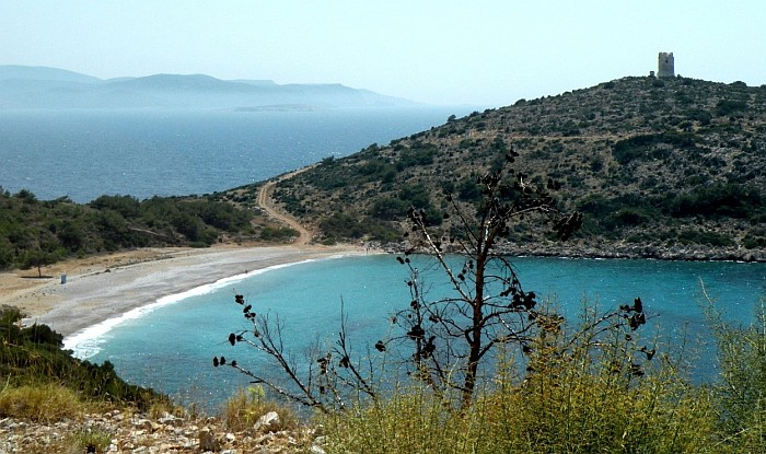 The wild beach Trahili, in the background on the hill very well preserved Watchtower