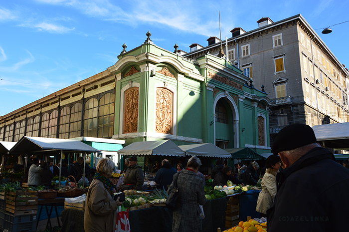 Fruit/vegetable stands and meet hall in the back (green building)
