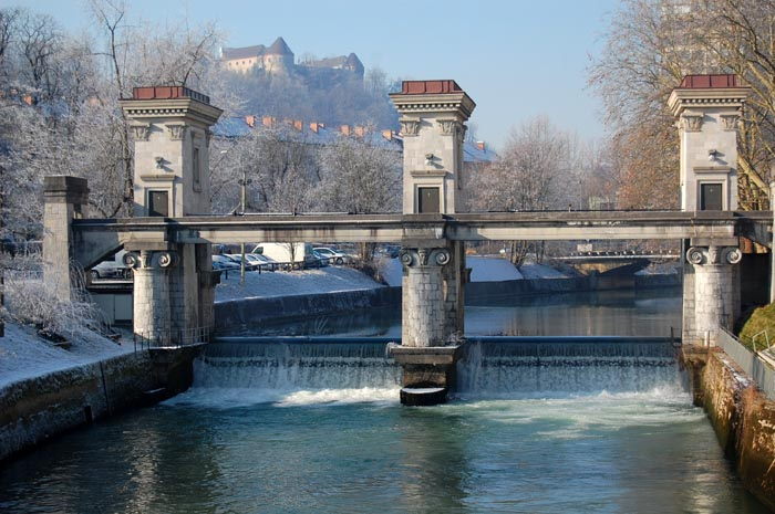 Winter wonderland: Jože Plečnik's river barrier and a view of the Ljubljana Castle