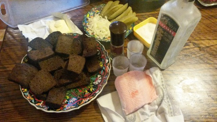 Russian classy Stroganina: fried bread slices in butter, sliced raw salmon on the bread with pickle,onion and black pepper. you eat it after you drink the shot of vodka. the taste is inexplainable. (Kiev)