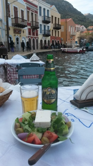 delicious Greek beer and Greek salad. Saganaki just arrived after I took the photo