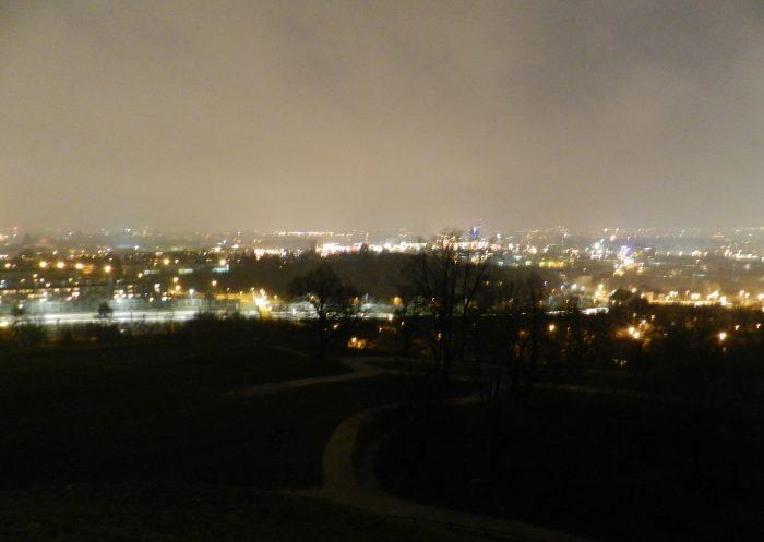view of Krakow by night from Kopiec Kraka Mountain